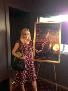 Suzi Lorraine beside a Scavenger Killers poster at the Hoboken International Film Festival.