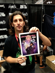 Anthrax bassist Frank Bello poses with his copy of Wicked Game.